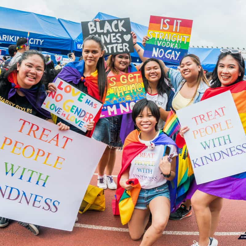 A group of people holding Pride signs