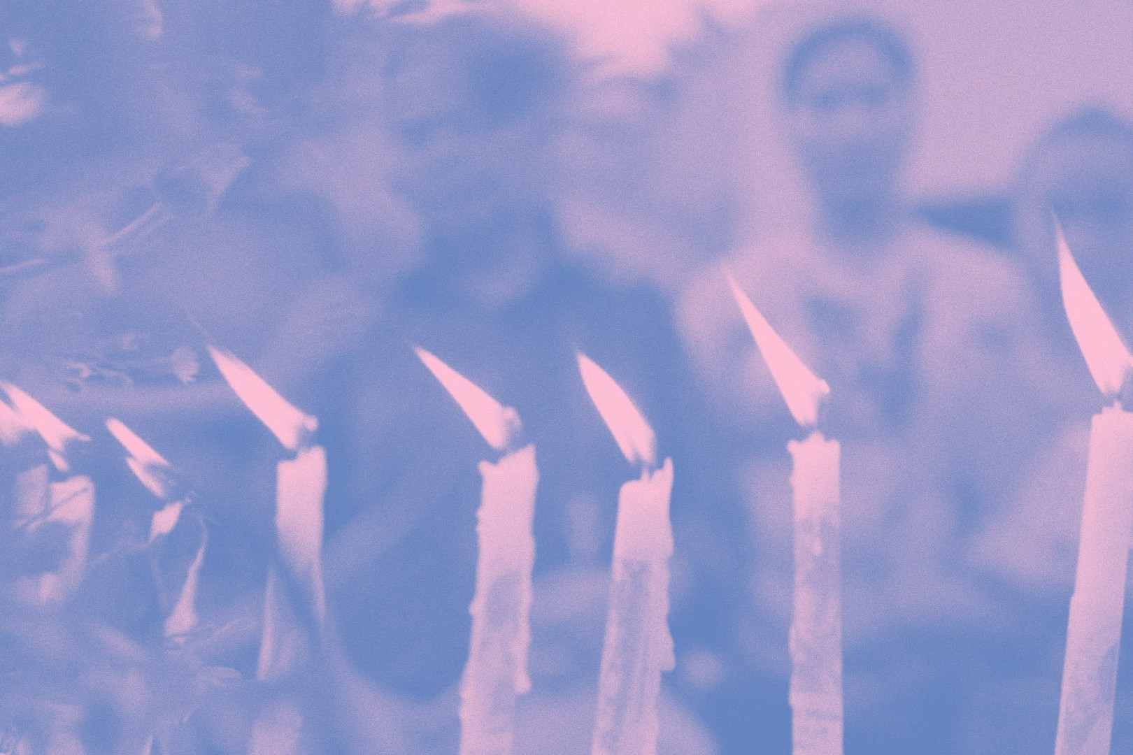 An image of lit candles in the foreground, people in the background. The image is awash in pink and blue gradients.